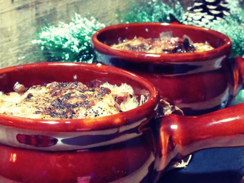 Onion soup au gratin with black garlic