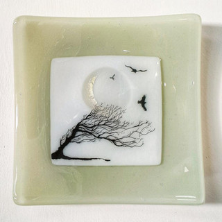 Windswept tree and silver moon dish on celadon glass