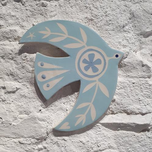 Light blue bird wall plaque