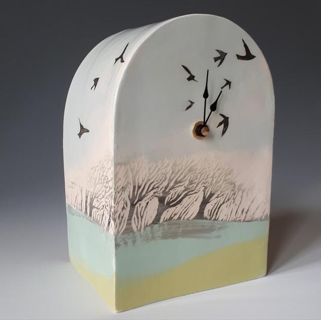 Windswept trees clock