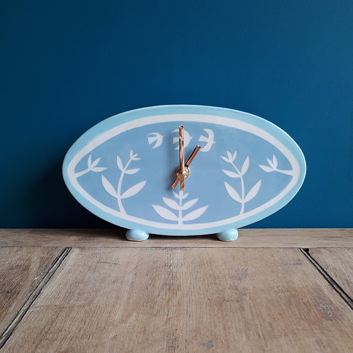 Sea blue oval standing clock