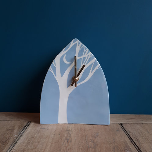 The shelter of trees clock