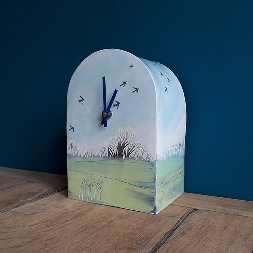 Windswept trees clock