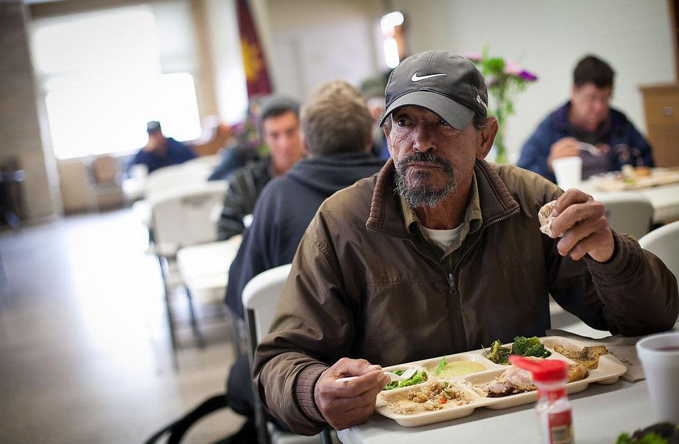 homeless men eating at SA shelter.jpg