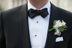 Groom wears classic black & white