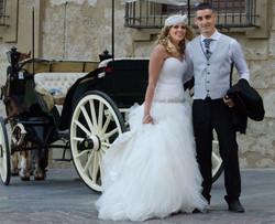 Bride & groom, their carriage awaits