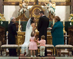 A bride, a groom and 2 peachy kids