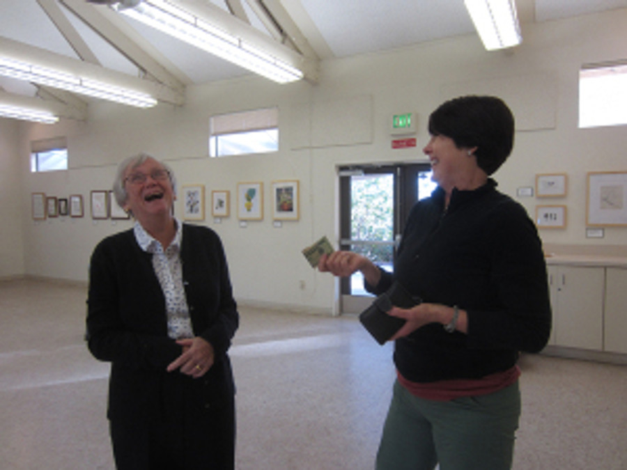 (left to right) Joan Keesey and Janice Sharp share a laugh before the Artists' Reception.