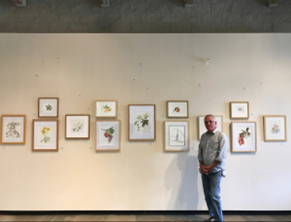 Andrew Mitchell with final exhibition display.