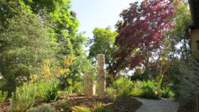 Standing stones in the completed front garden are reclaimed Kansas fence posts, pieces of ancient ocean limestone bed, used to mark farm boundaries in a prairie ecosystem lacking trees.Photo © 2016, Cordelia Donnelly.