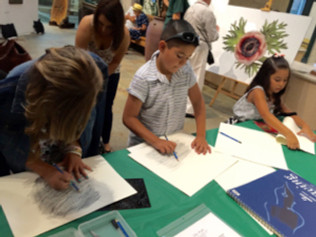 Exploring stencil leaf rubbings in graphite and colored pencil at The Huntington.