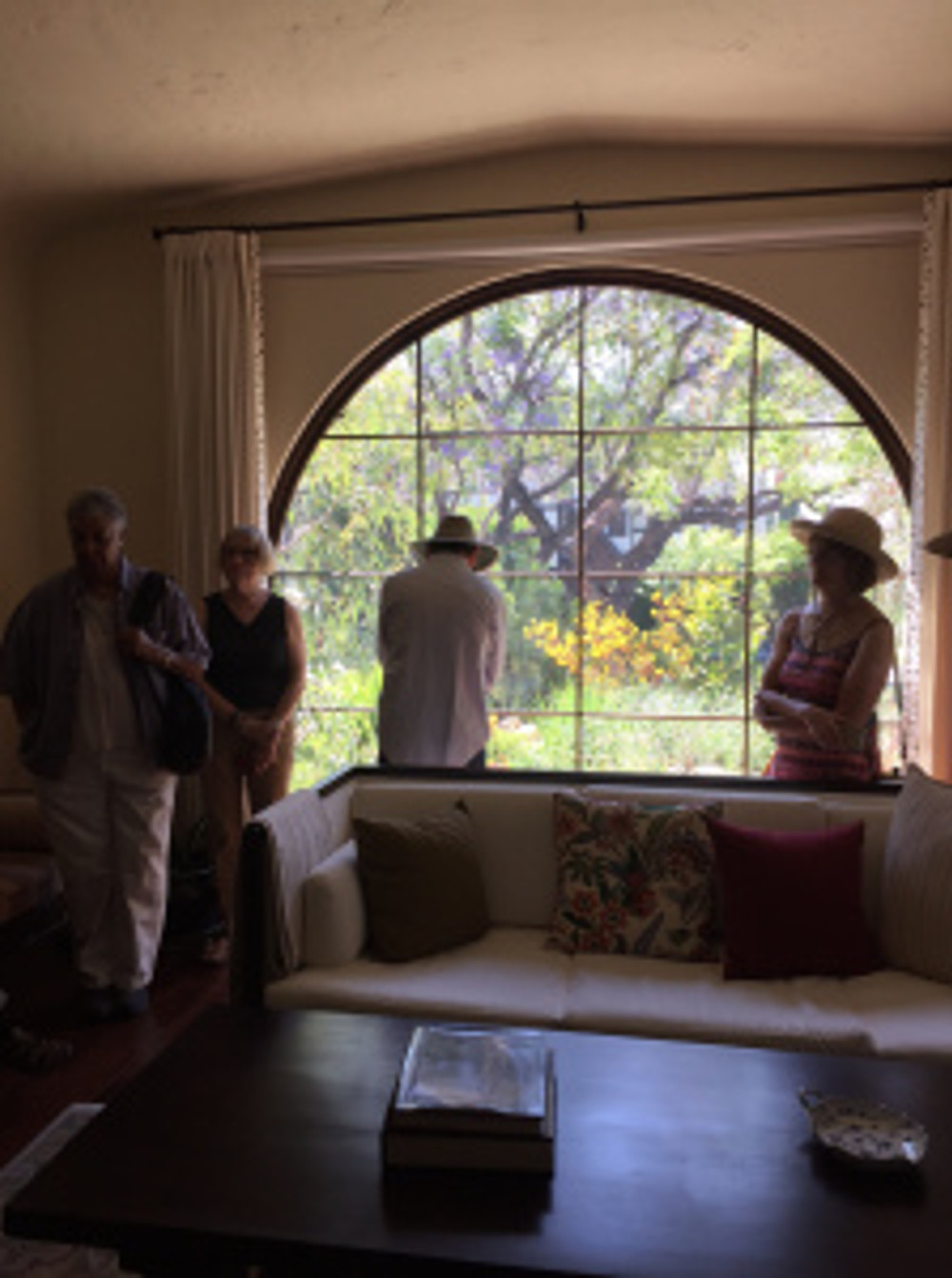 Looking from the front room out to the garden. The windows are laminated to dampen noise from the street. Photo by Clara Josephs, © 2016.
