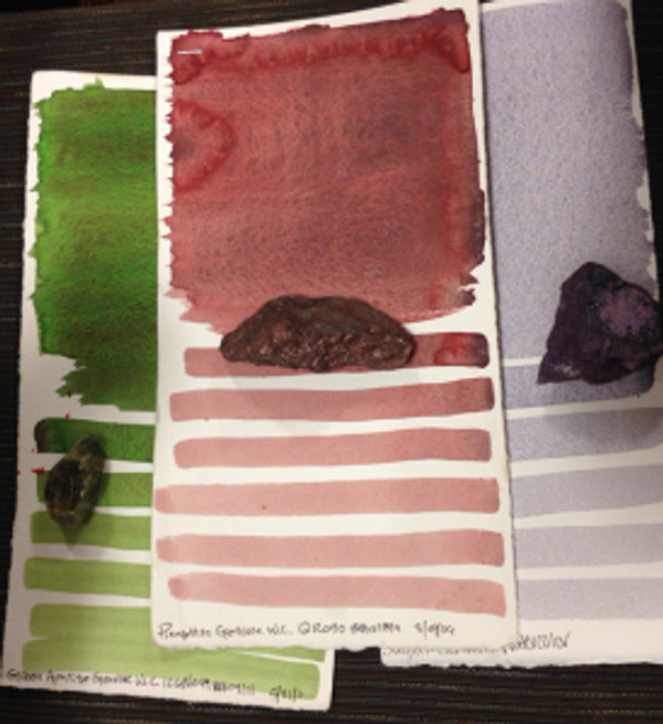 """Testing of pigment, showing the original pigment """"rock"""" with the swatch test. Photo by Deb Shaw."""
