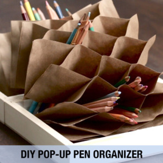 Buzzfeed's finished DIY pencil holder, open. © 2016 Buzzfeed Nifty.