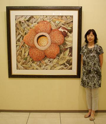 Mieko Ishikawa with painting at Exhibition at Keio Plaza Hotel, Shinjuku, Tokyo.