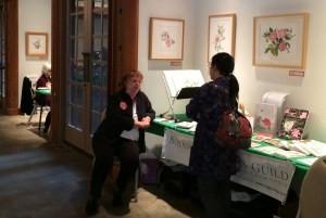 Artist Tania Norris chatting with Camellia enthusiast Hiromi Sato.