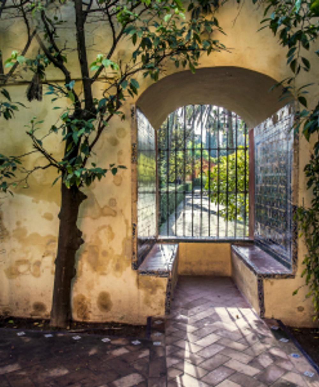 The tiled garden view in Alcazar Palace Gardens, © Quench Travel.