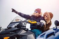 Lovers. guy and girl on a snowmobile. Co