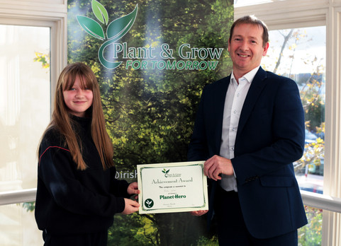 Aoibhe from Ballindaggin NS recieving her Planet Hero Certificate