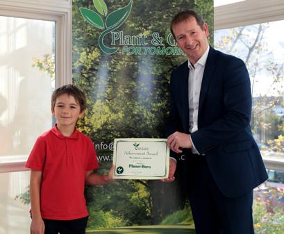 Ruari getting his Planet Hero Certificate