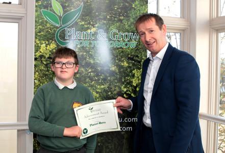 Ryan recieving his Planet Hero Certificate