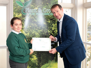 Cloadh Poole getting her Planet Hero Certificate