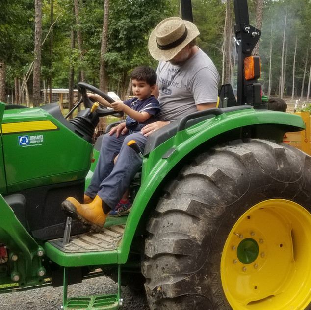 ride a tractor pet goats nc.jpg
