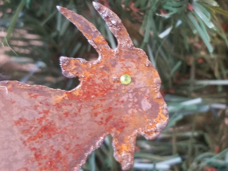 Rusty goat Christmas ornament with green eye