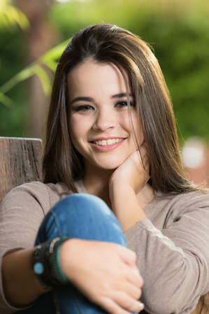 Ensaio fotográfico de 15 anos, debutante rindo