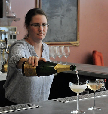Courtney pours Champagne