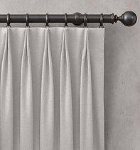Metal curtain rod with drapes.jpg