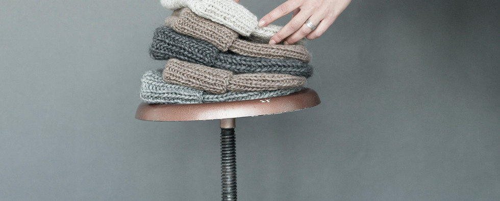 woman-staking-five-assorted-color-beanie