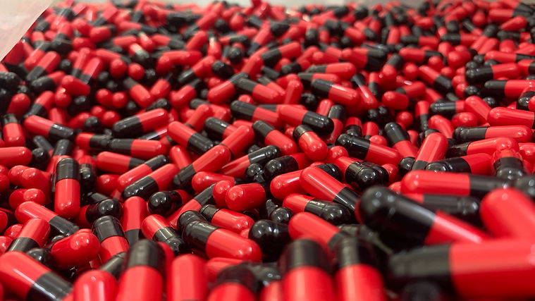 black _ red capsules .JPEG