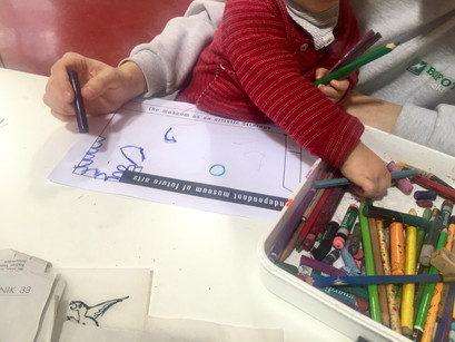 children drawing in the educational department