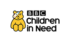 Begin image. Pudsey Bear, a yellow teddy bear with a polka-dot bandana covering one eye, sits next to the words 'BBC Children In Need' written in a friendly sans-serif font. End image.