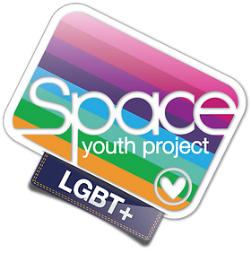 Begin Image. The SYP Logo is a rounded rectangle, rotated 45 degrees so the top-left corner is uppermost. It is bordered in white, with the same eight-colour rectangle running at the same angle as the rectangle. Space Youth Project is written horizontally across the rectangle. In the bottom right corner is a white heart in a circle. On the bottom edge of the rectangle, a tag stylised to look like denim is hanging off, with 'LGBT+' written across it in white. End image.