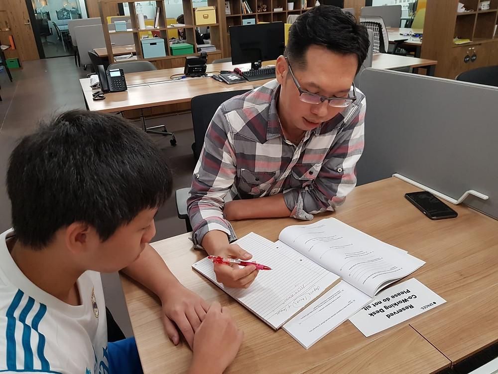 Principal tutoring a student