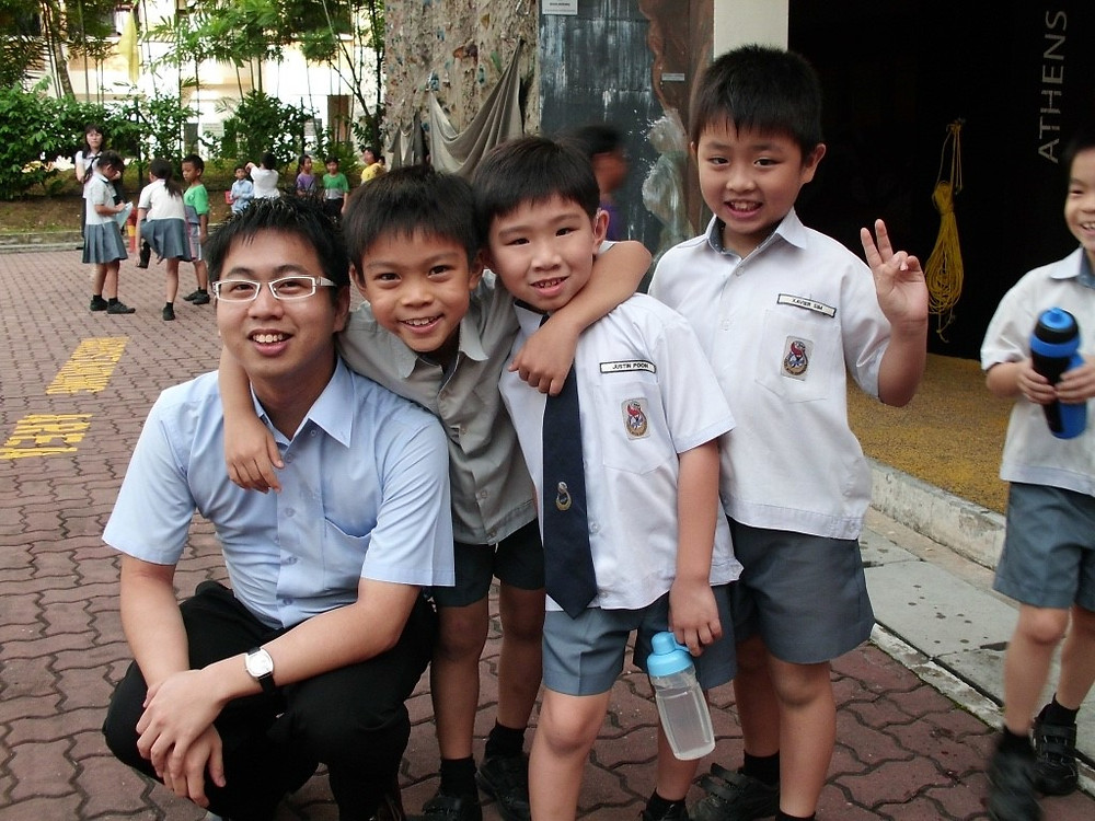 Tutor Joel with his students