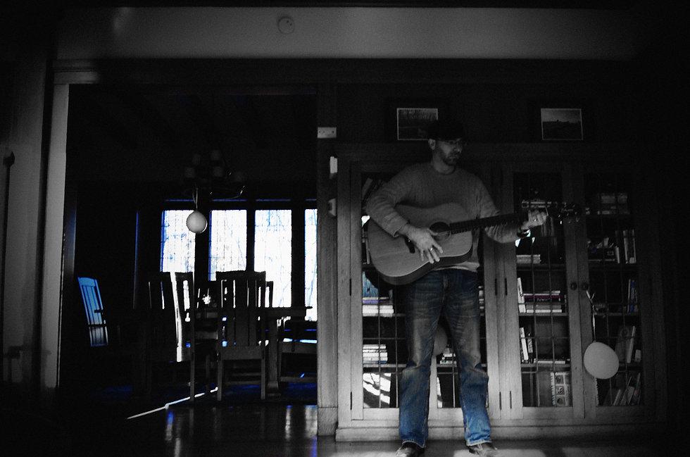 m gargo plays guitar