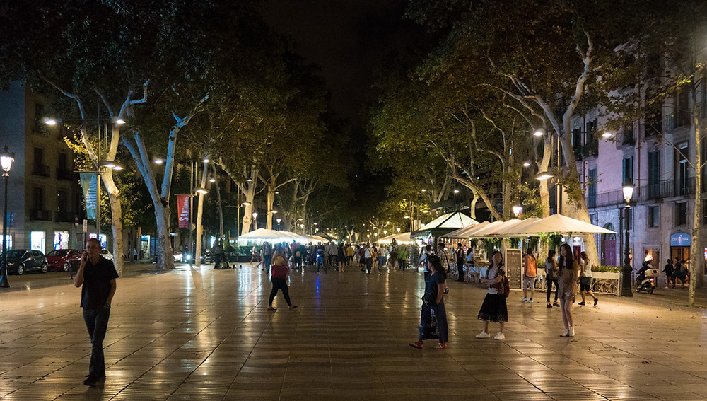 Las Ramblas is a popular street for dining and nightlife and connects Plaça de Catalunya to Port Vell.