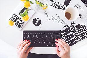 girl-writing-on-a-black-keyboard-6469 (2