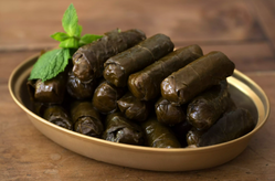 Dolmathakia (Stuffed Grape Leaves With Rice and Herbs)