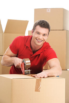 Young man packing boxes to move in new f