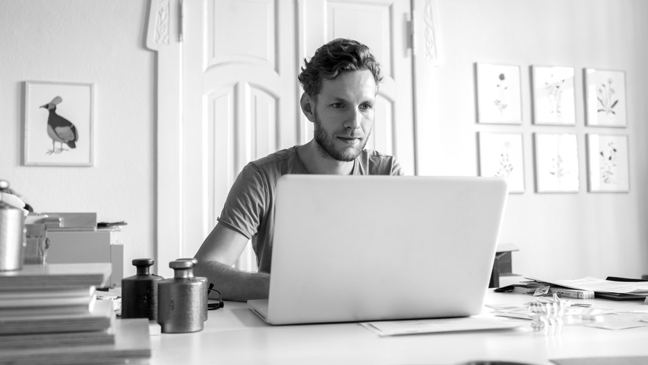 Should Staff Who Work From Home Be Paid Less?