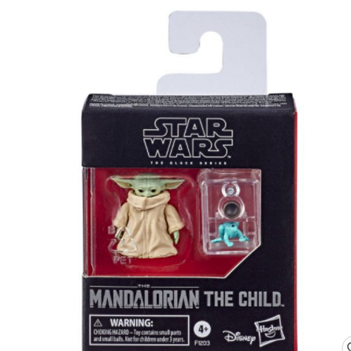 Tiny baby Yoda and frog figure