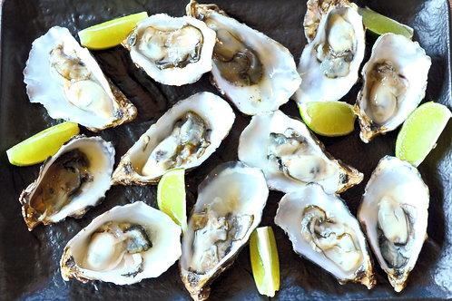 dozijn oesters met oestermes