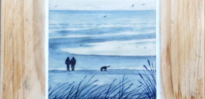 Couple and dog on the beach