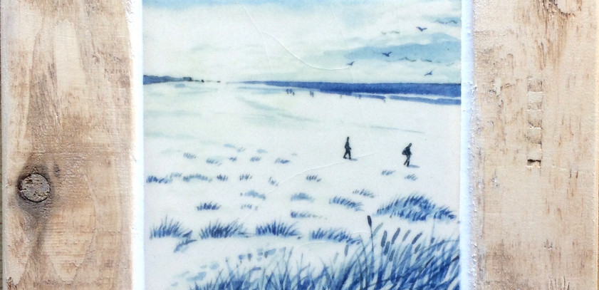 Walkers on the beach