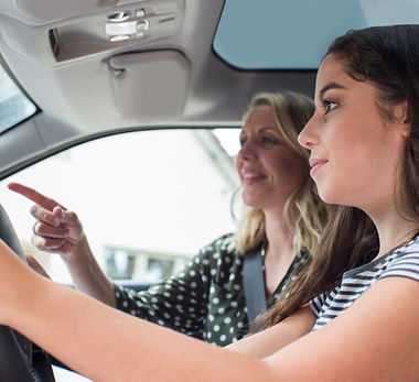 Teenager Having Driving Lesson With Female Instructor.jpg