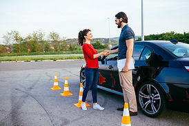 Driving school or test. Beautiful young
